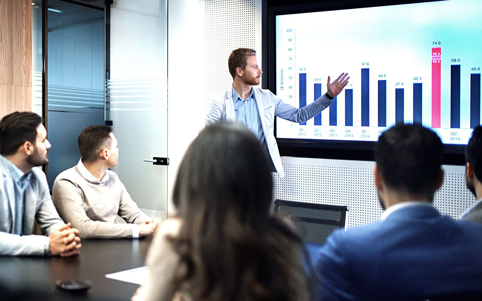 man presenting a graph in a meeting