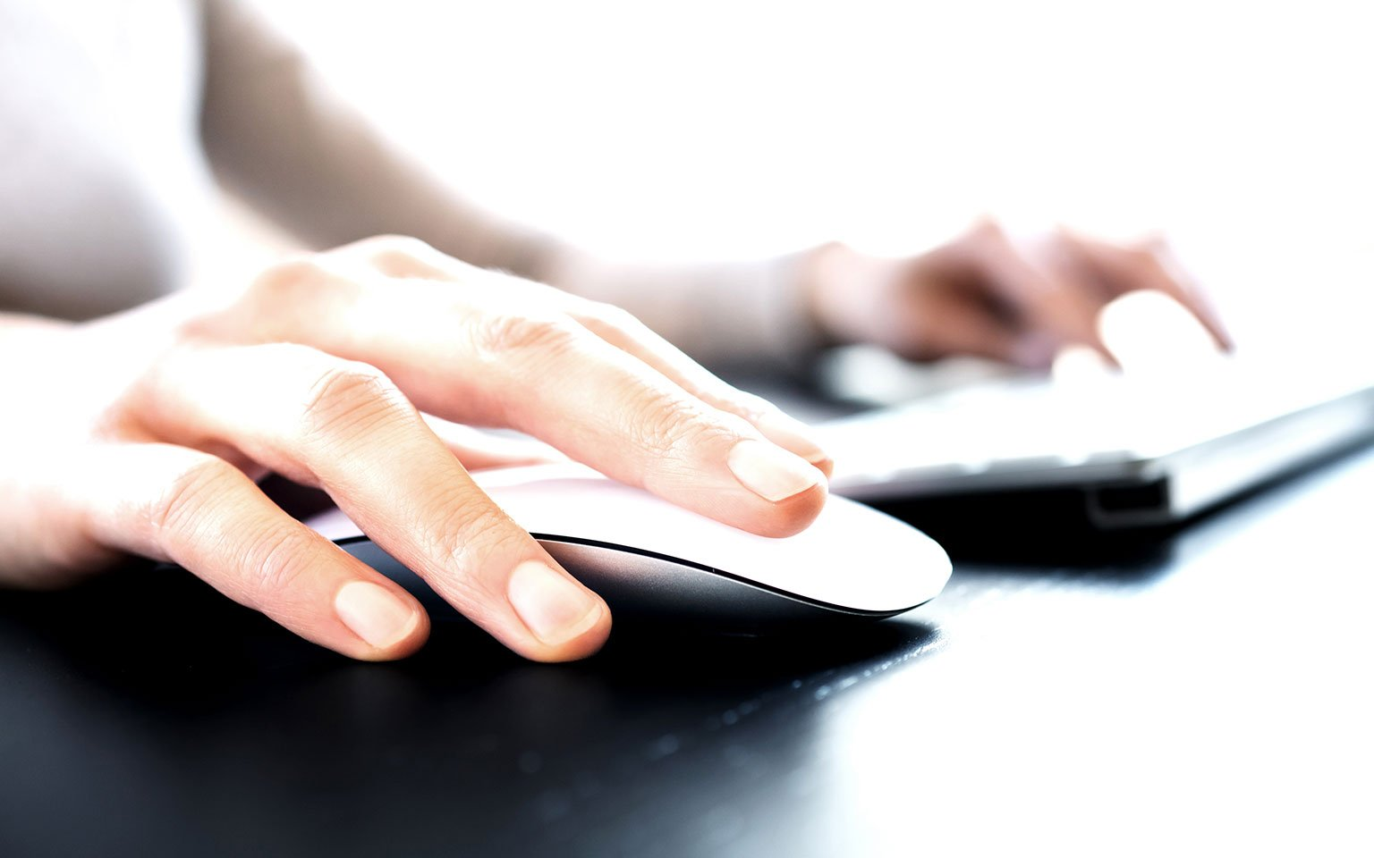 close up of hands typing on a laptop